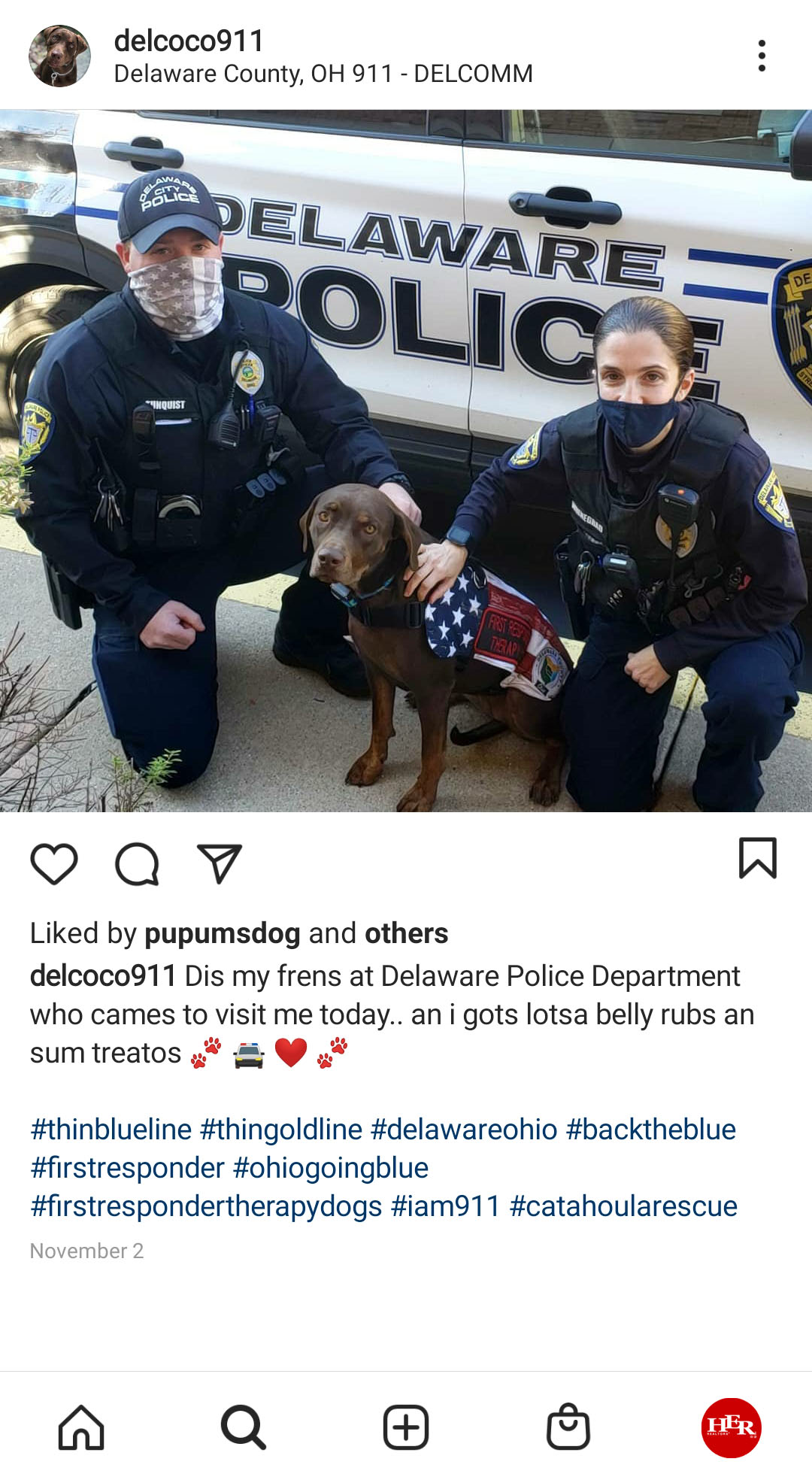 Two Officers with cop dog
