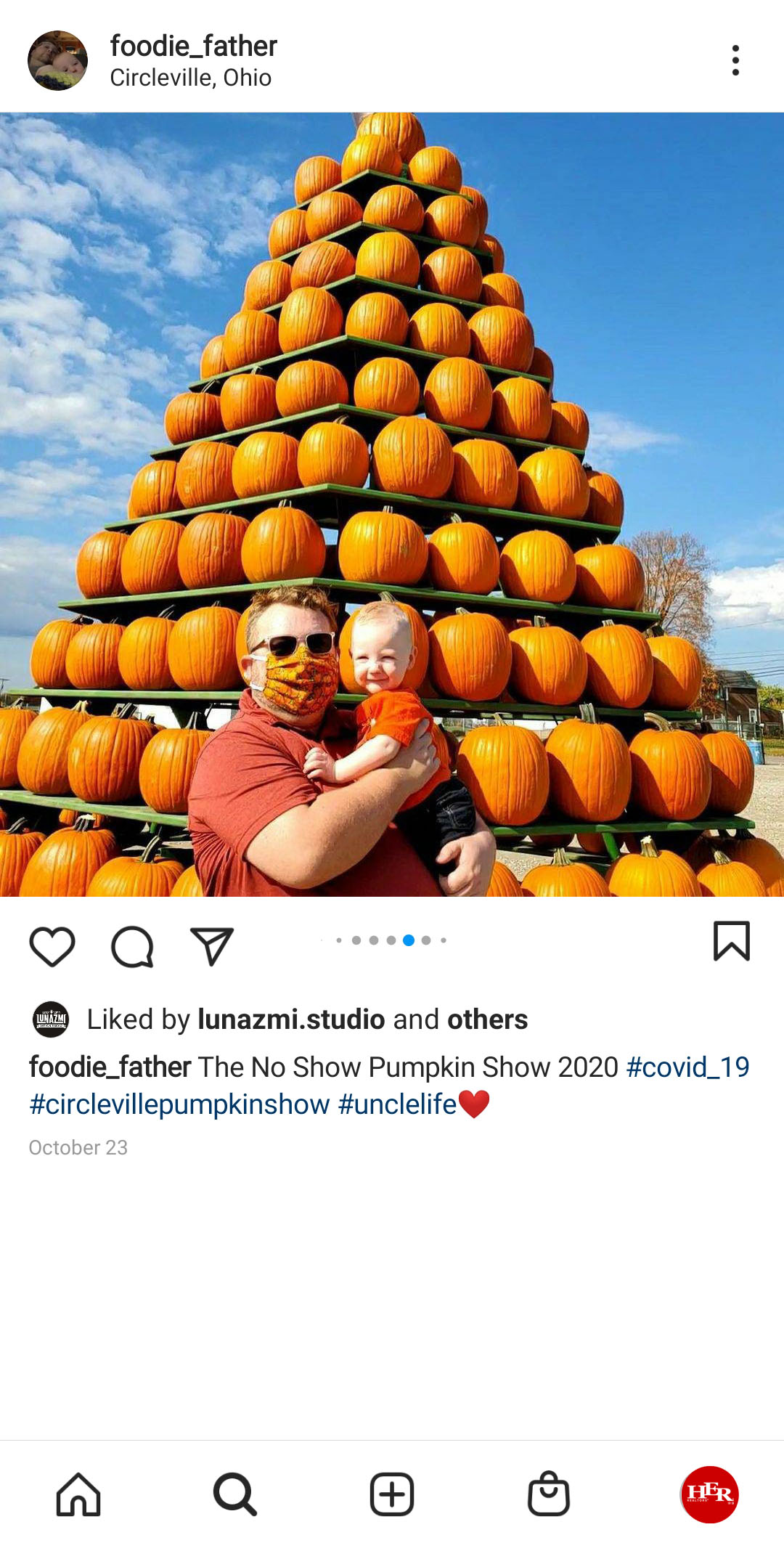 A man with his baby at pumpkin show