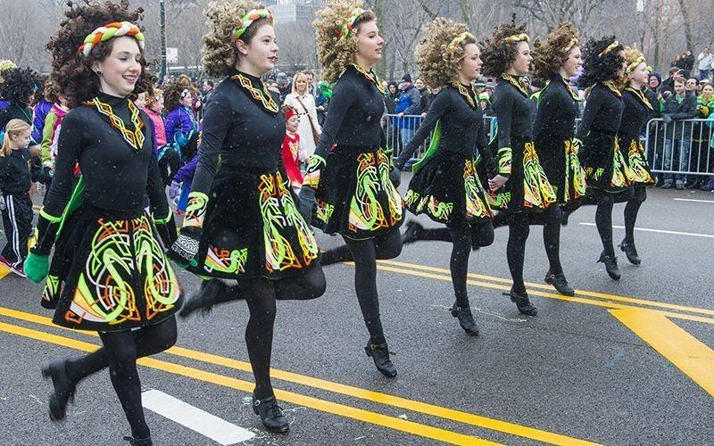 Irish dancers perform in a parade