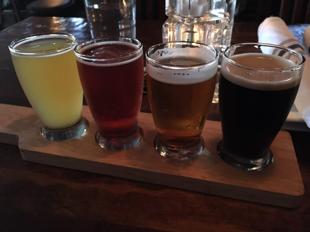 An image depicting Arch City Tavern's beer flights that give you a sample of four different beers!