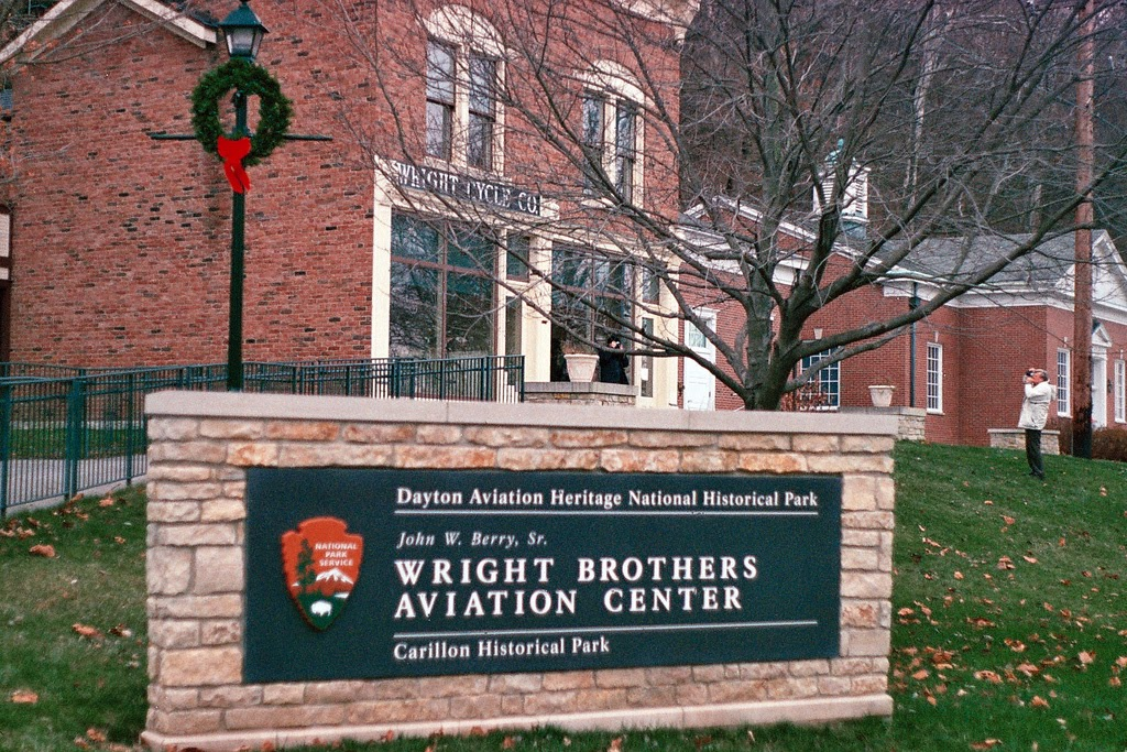 Wright Brothers Aviation Center sign in front of red brick buildings