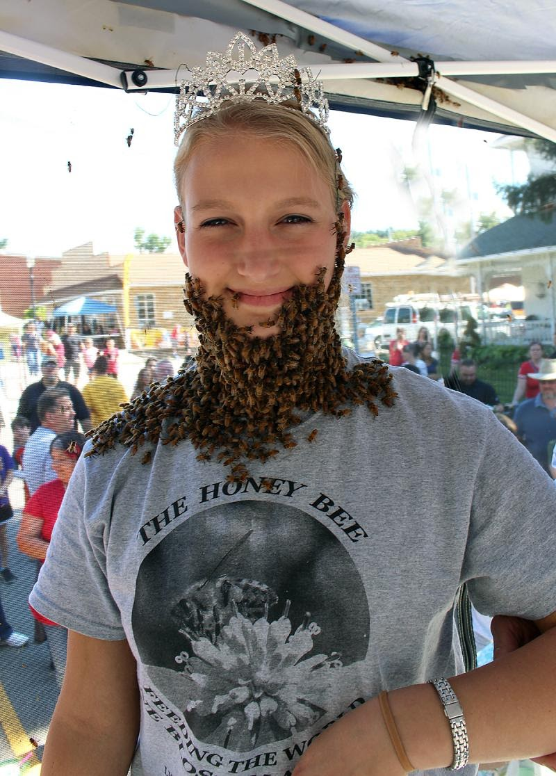 Lithopolis Honeyfest pageant queen smiling with bees covering face
