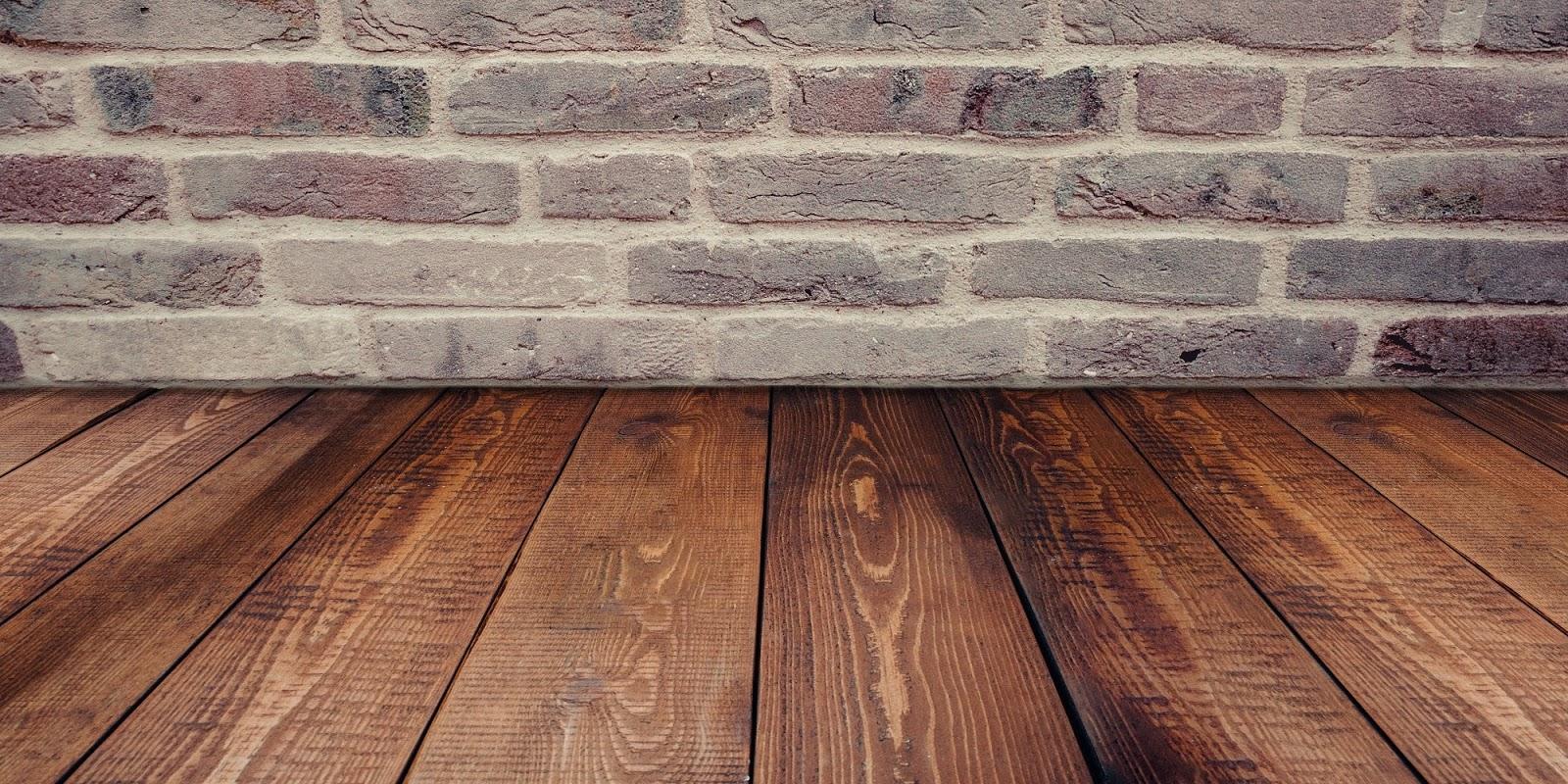 hardwood floor and brick wall