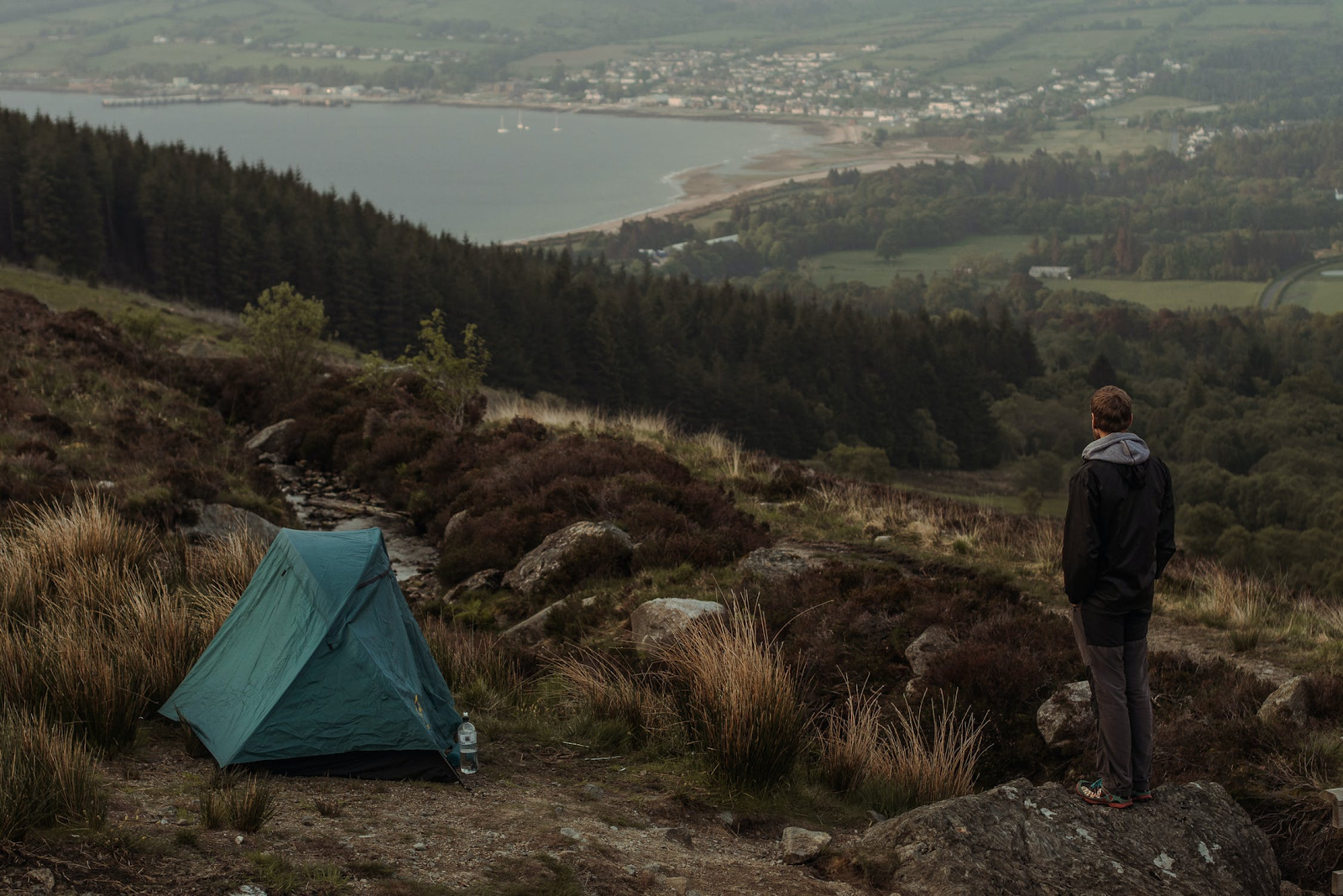 An image showing the beautiful scenes of nature you'd experience while camping.