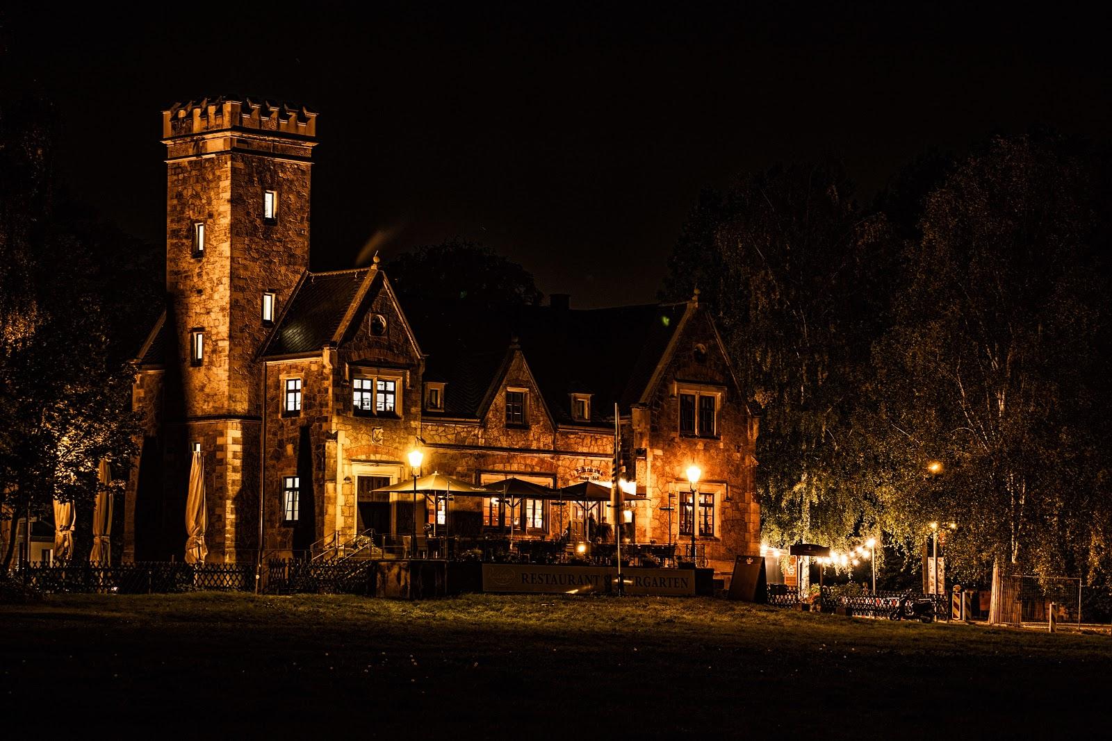 lit castle at night