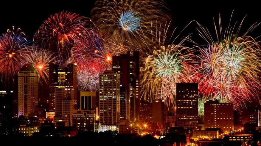 fireworks behind Columbus skyline at night