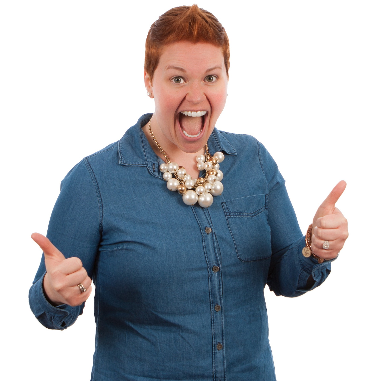 ecstatic woman with red hair giving two thumbs-up