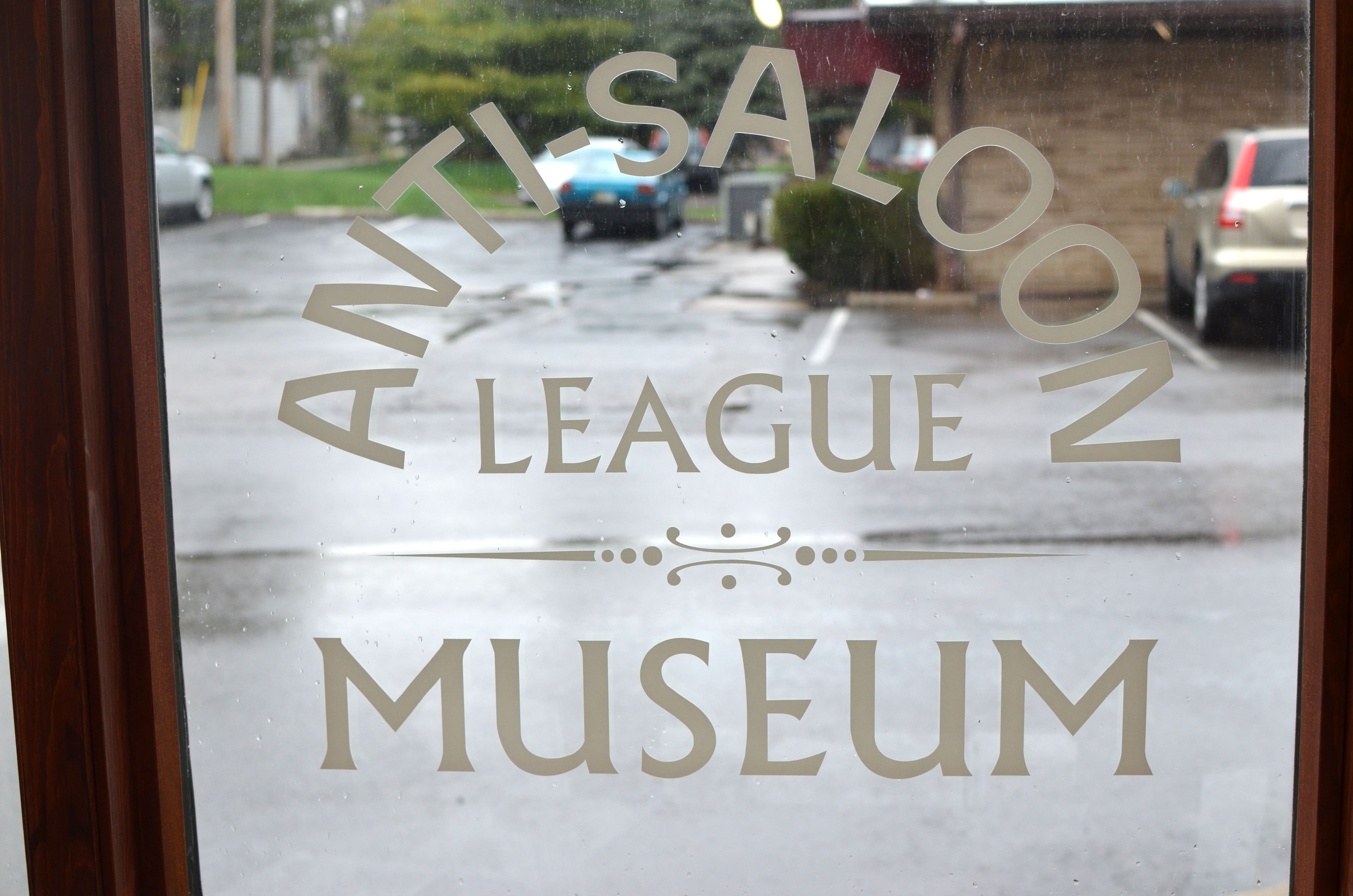 "window that reads ""Anti-Saloon League Museum"" from the inside"
