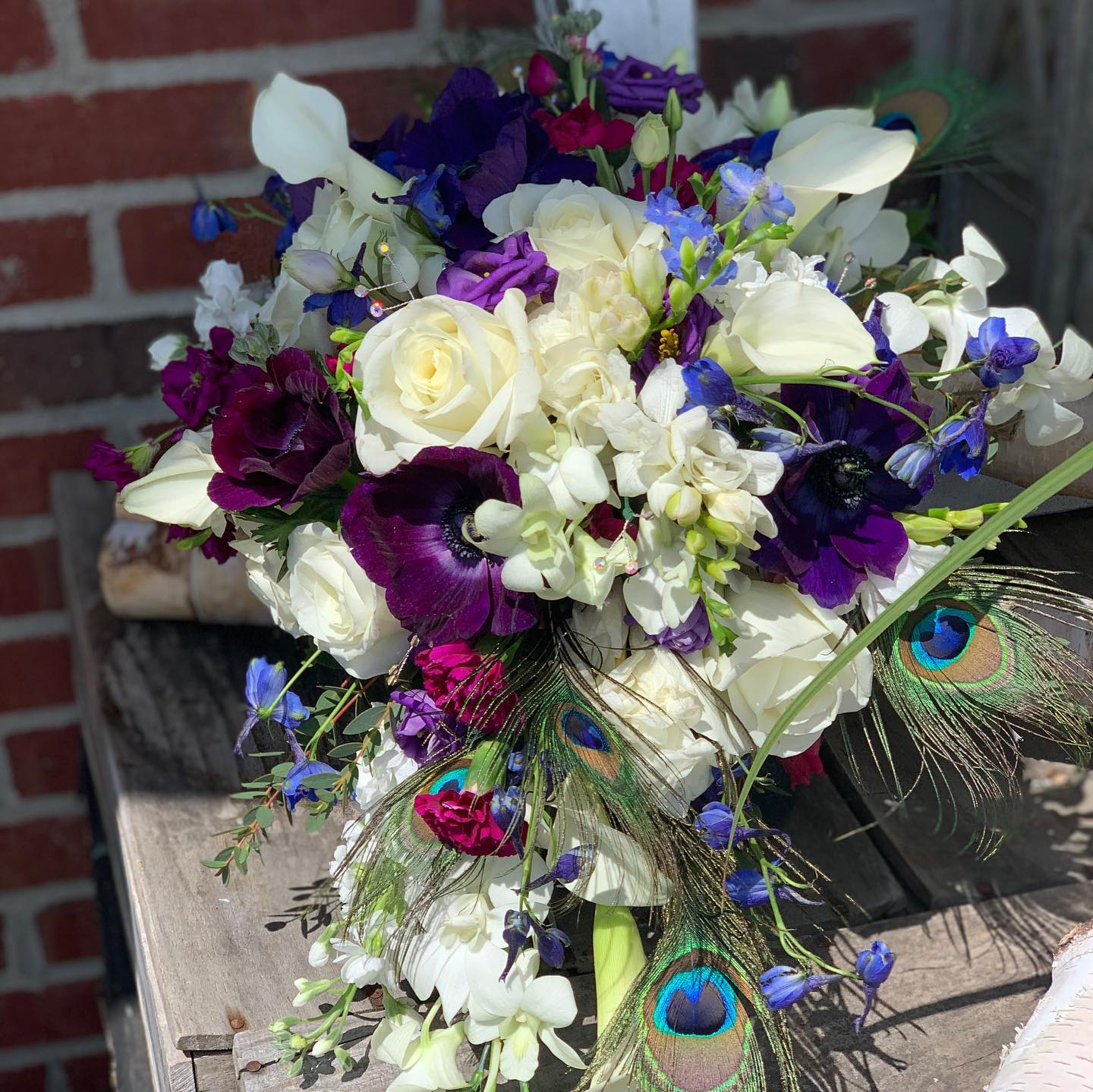 An image of a purple custom bouquet made at All inBloom!