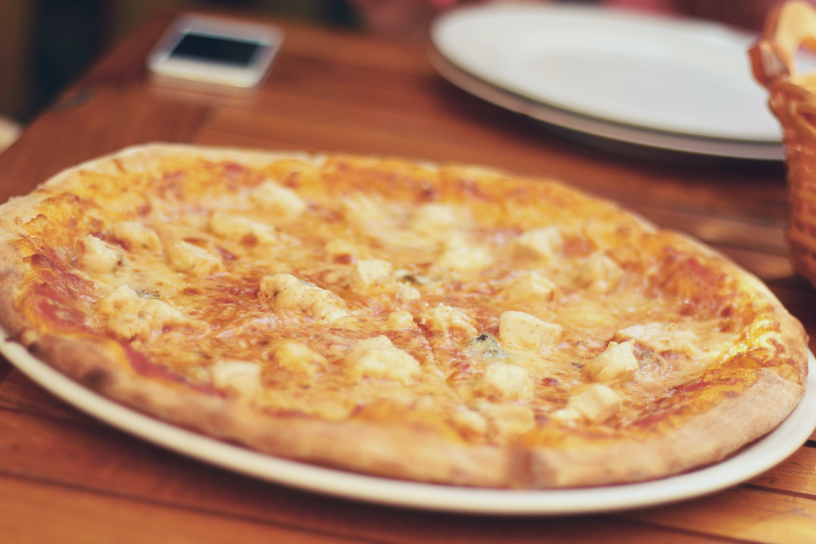 An image of a classic Italian-style pizza that can be found at Rocky's pizza.