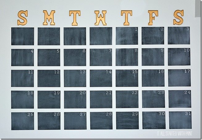 An image showing a painted chalkboard calendar.