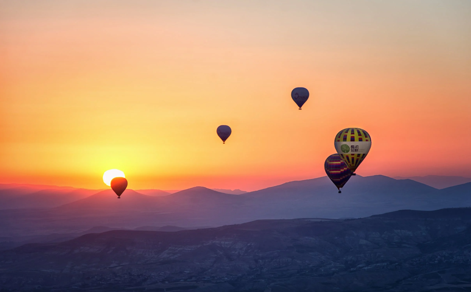 An image of hot air balloons for Gibboney's Aerostation.
