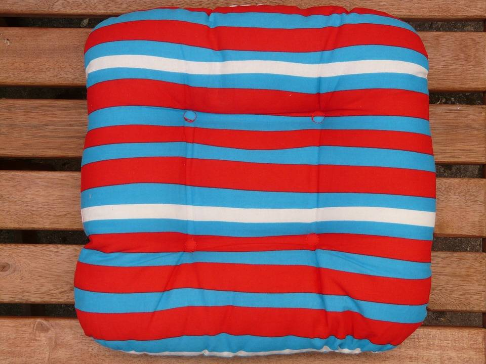 An image showing a painted striped pillow.