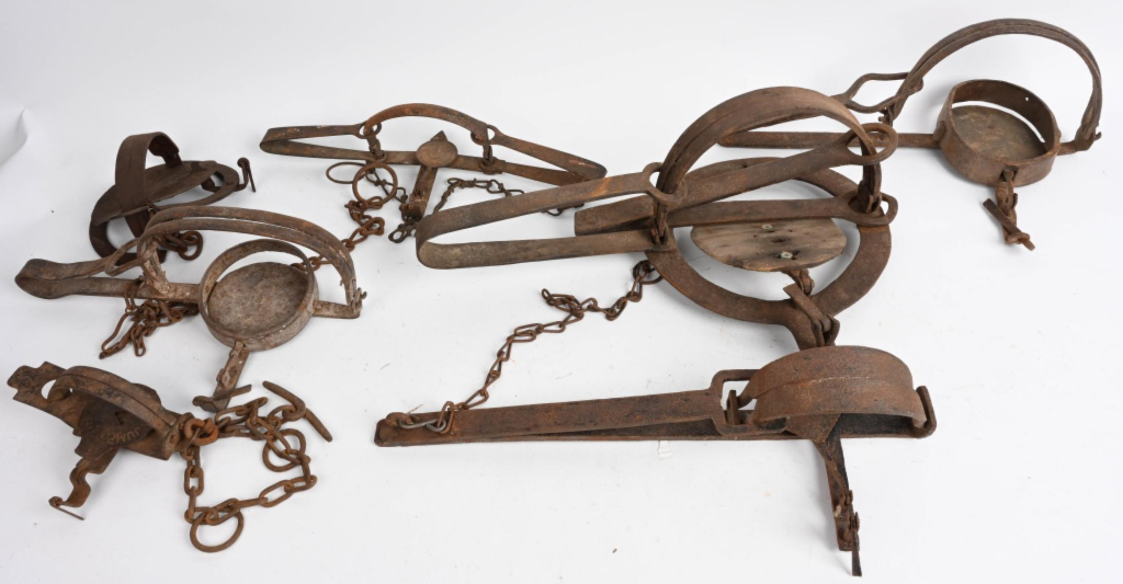 Several old animal traps on display.