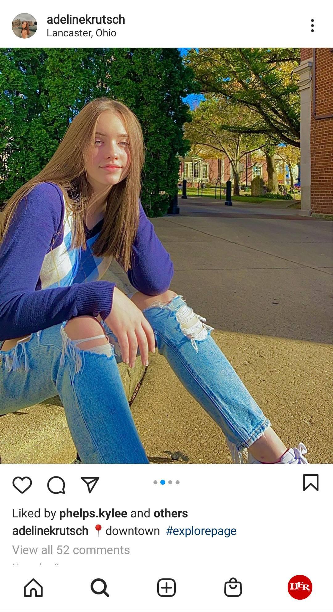 Young girl sit on sidewalk