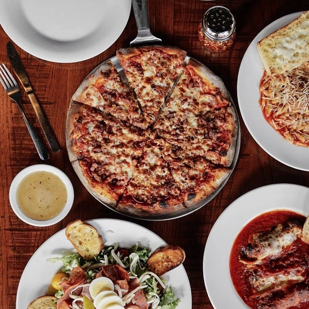 pizza, salad, dressing, and a few other Italian entrees