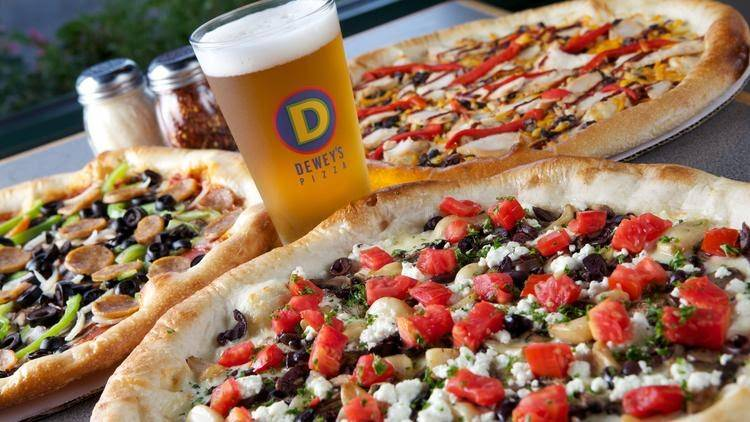 a cold beer and three pizzas