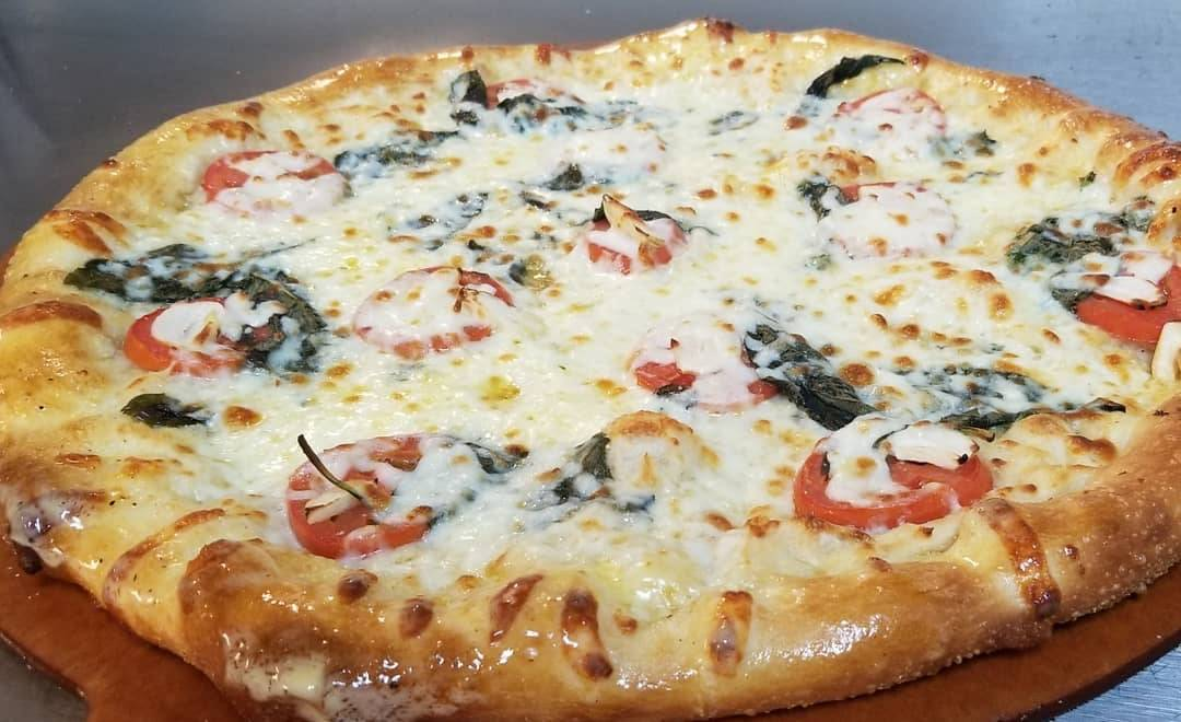 margarita pizza from Halwani Cuisine