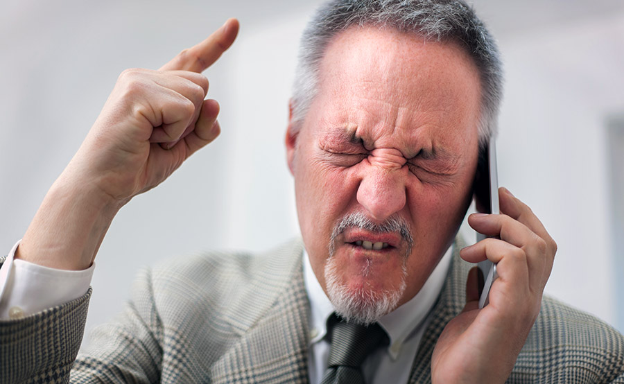 man receiving bad phone customer service