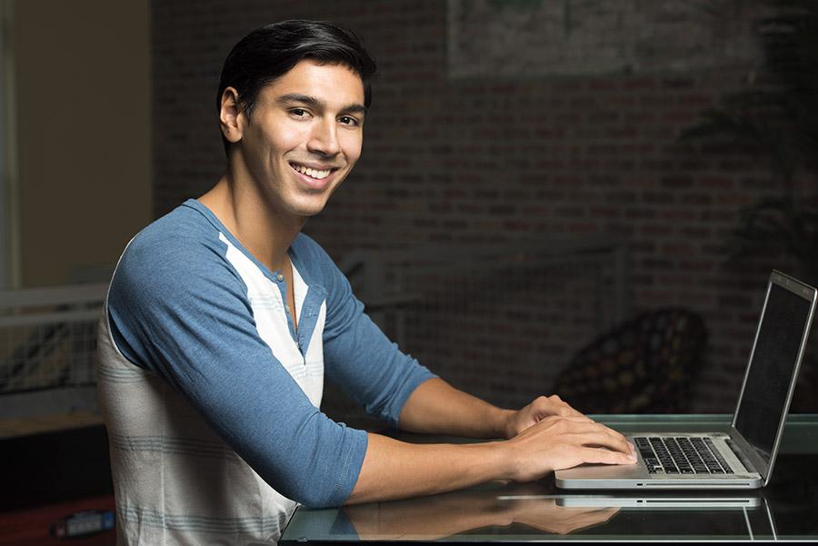 Hispanic youth at computer banking