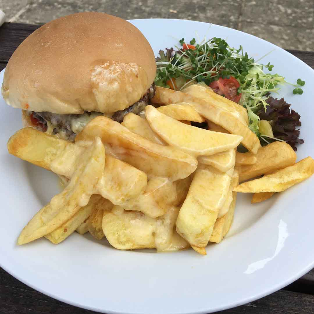 8oz Burger with Cheesy Chips and Salad