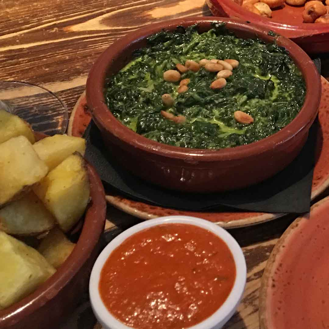 Spinach and Pine Nuts Dish, with Patatas Bravas