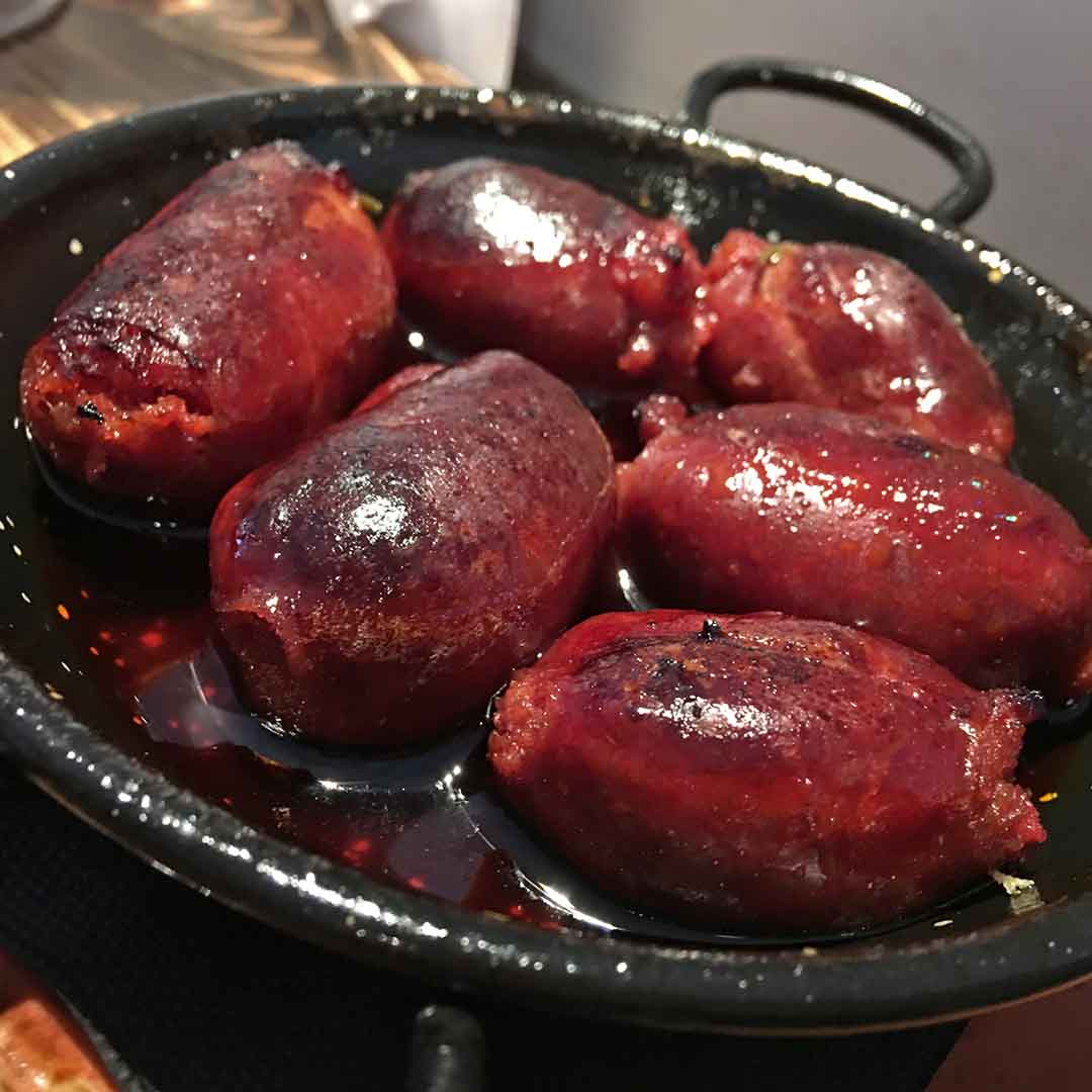 Fresh chorizo grilled in a red wine sauce