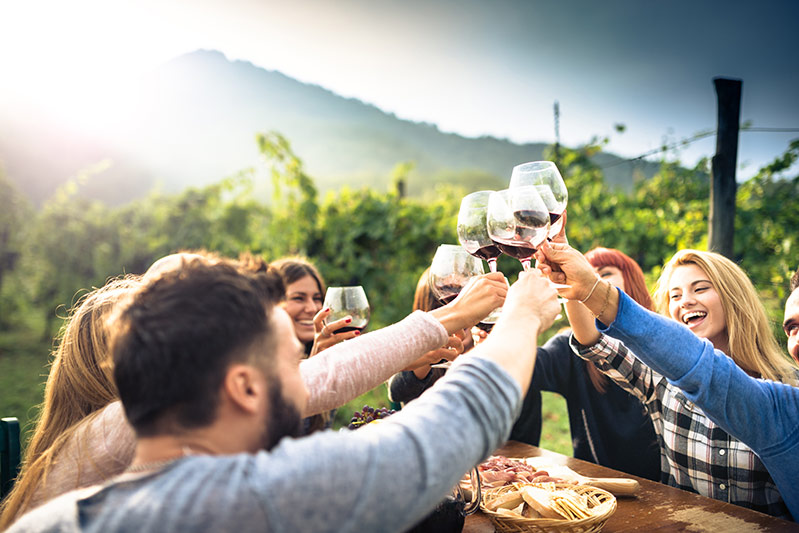 People enjoying wine together