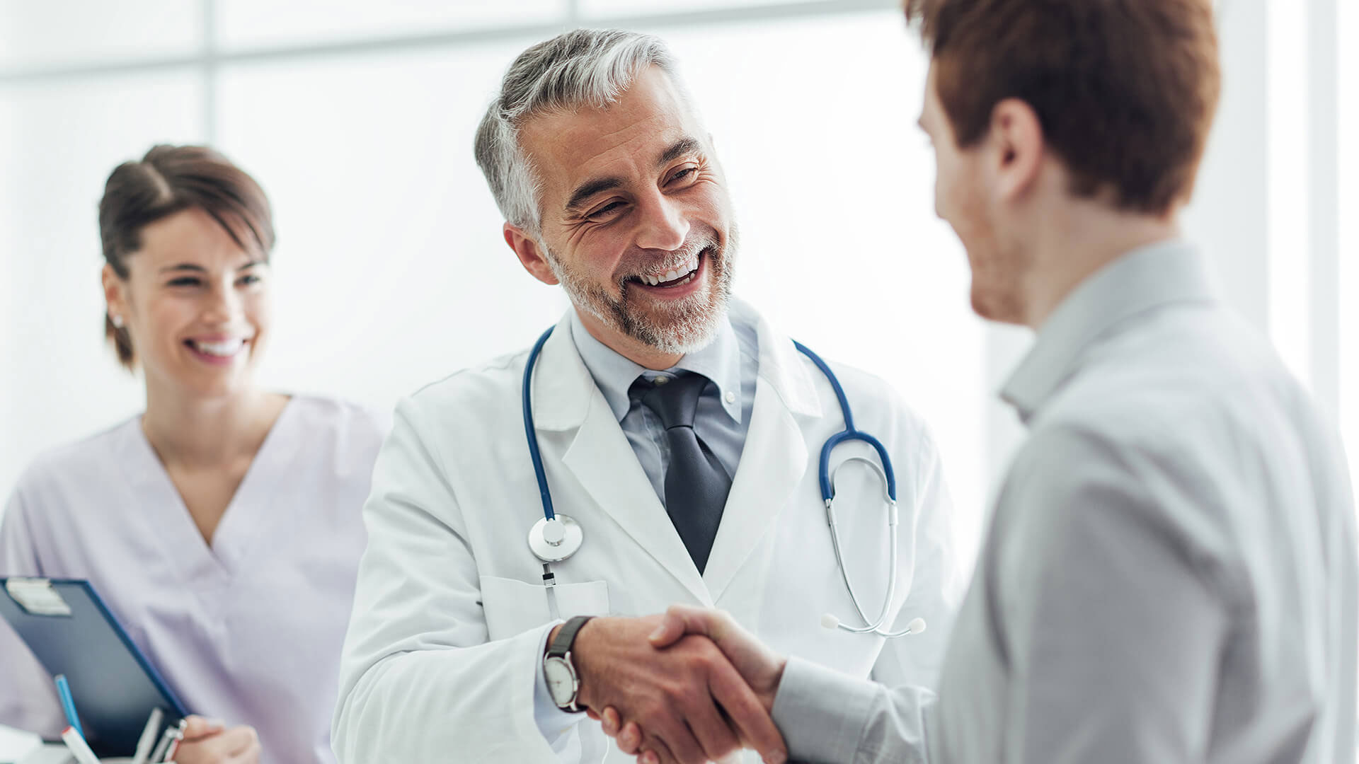 Out-of-network doctor greeting patient