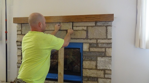 Worker Installing Fireplace
