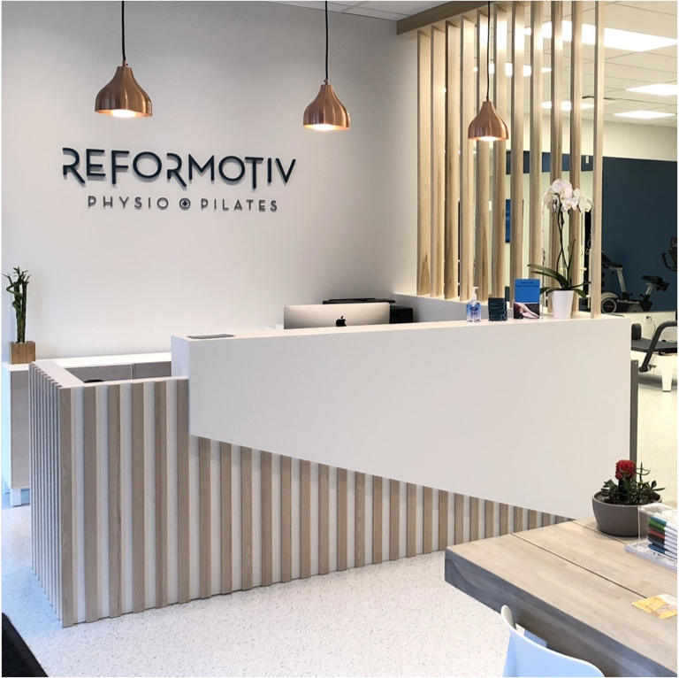 Reformotiv Physio + Pilates signage design by Flipside Creative.