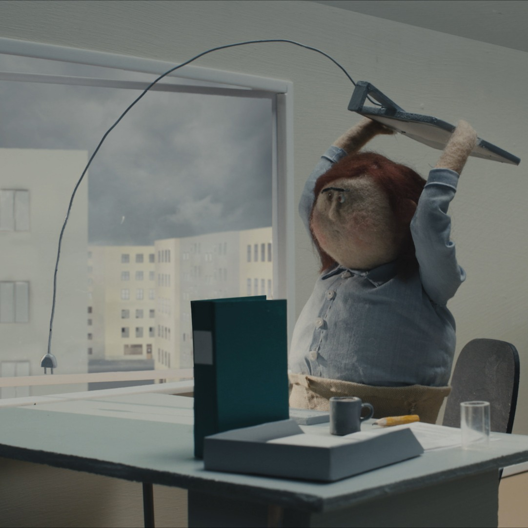 Animated office worker smashes keyboard.