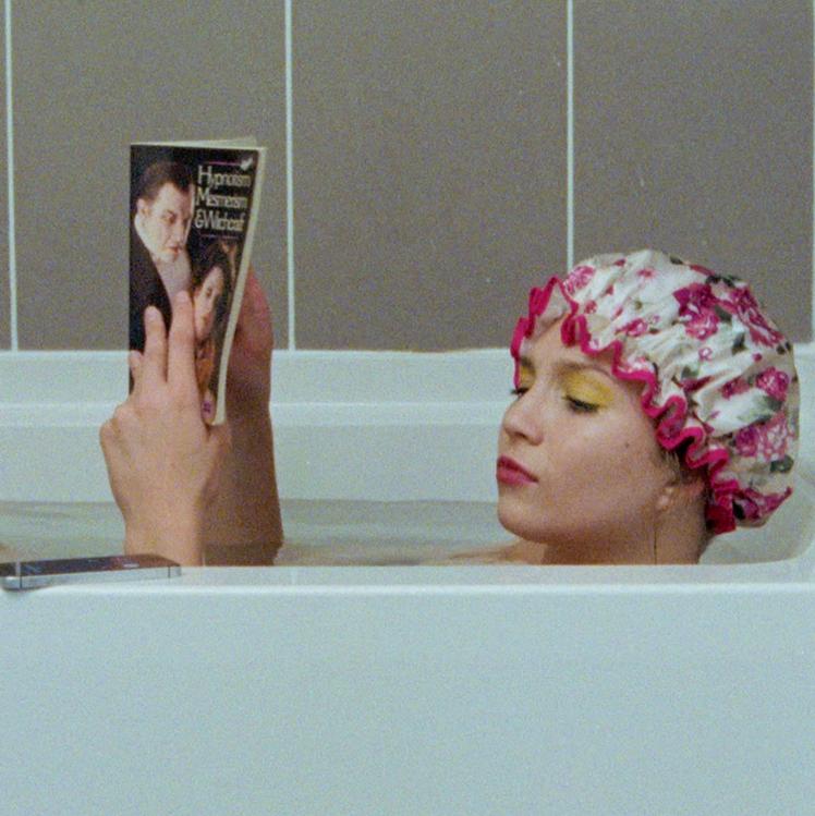 Woman read a book in the bath