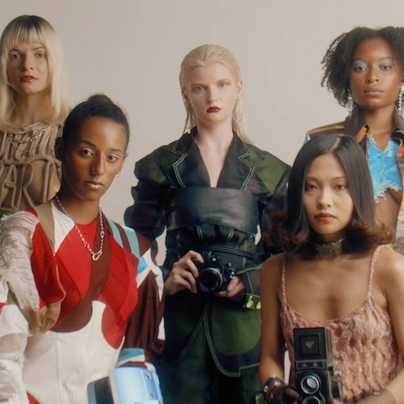Gang of women pose with cameras