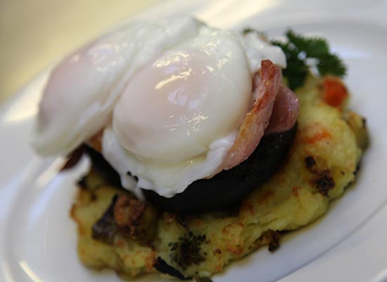 Photo of eggs, bacon, black pudding on bubble & squeak.