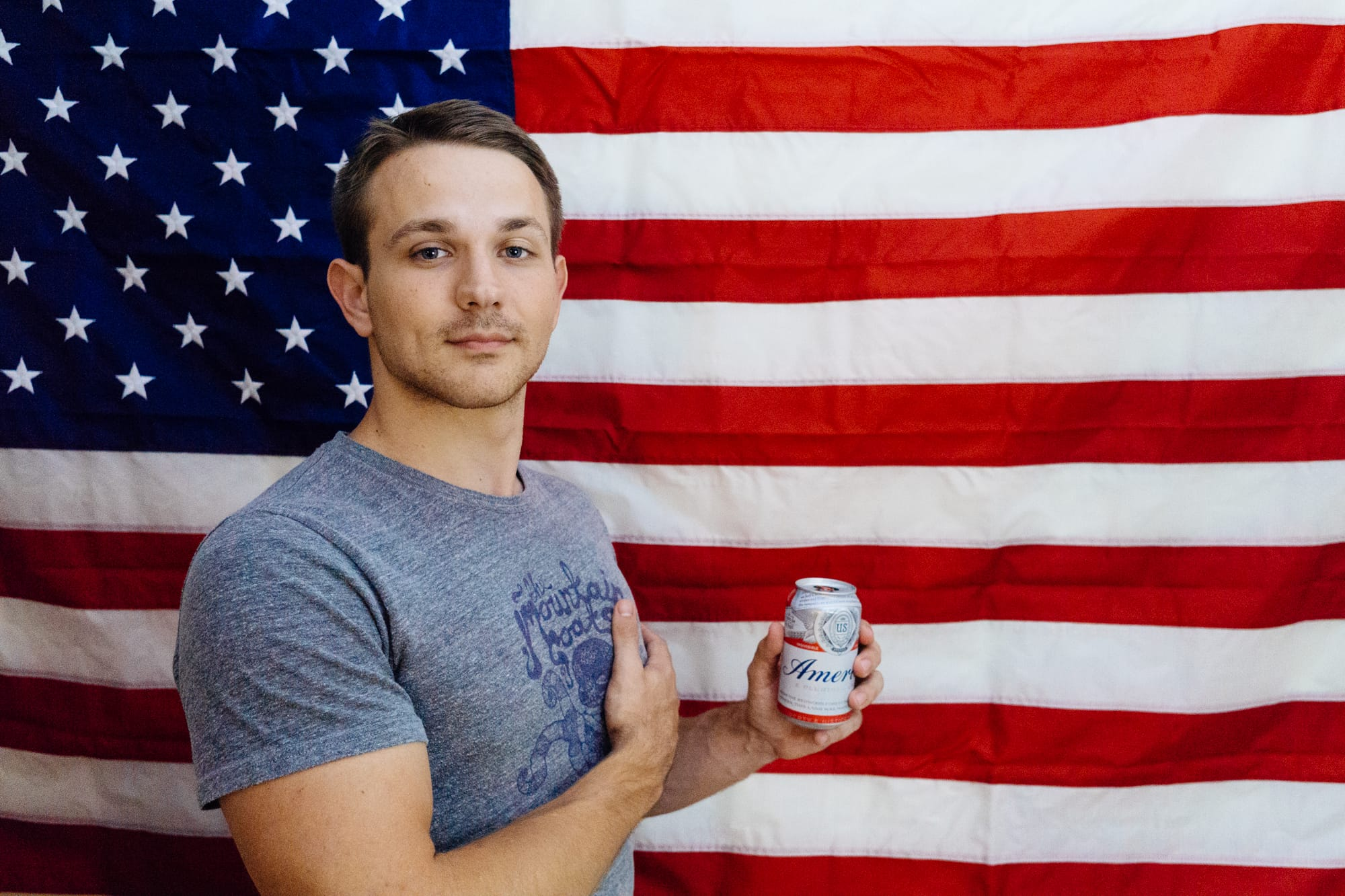 portrait of a man in front of an American flag