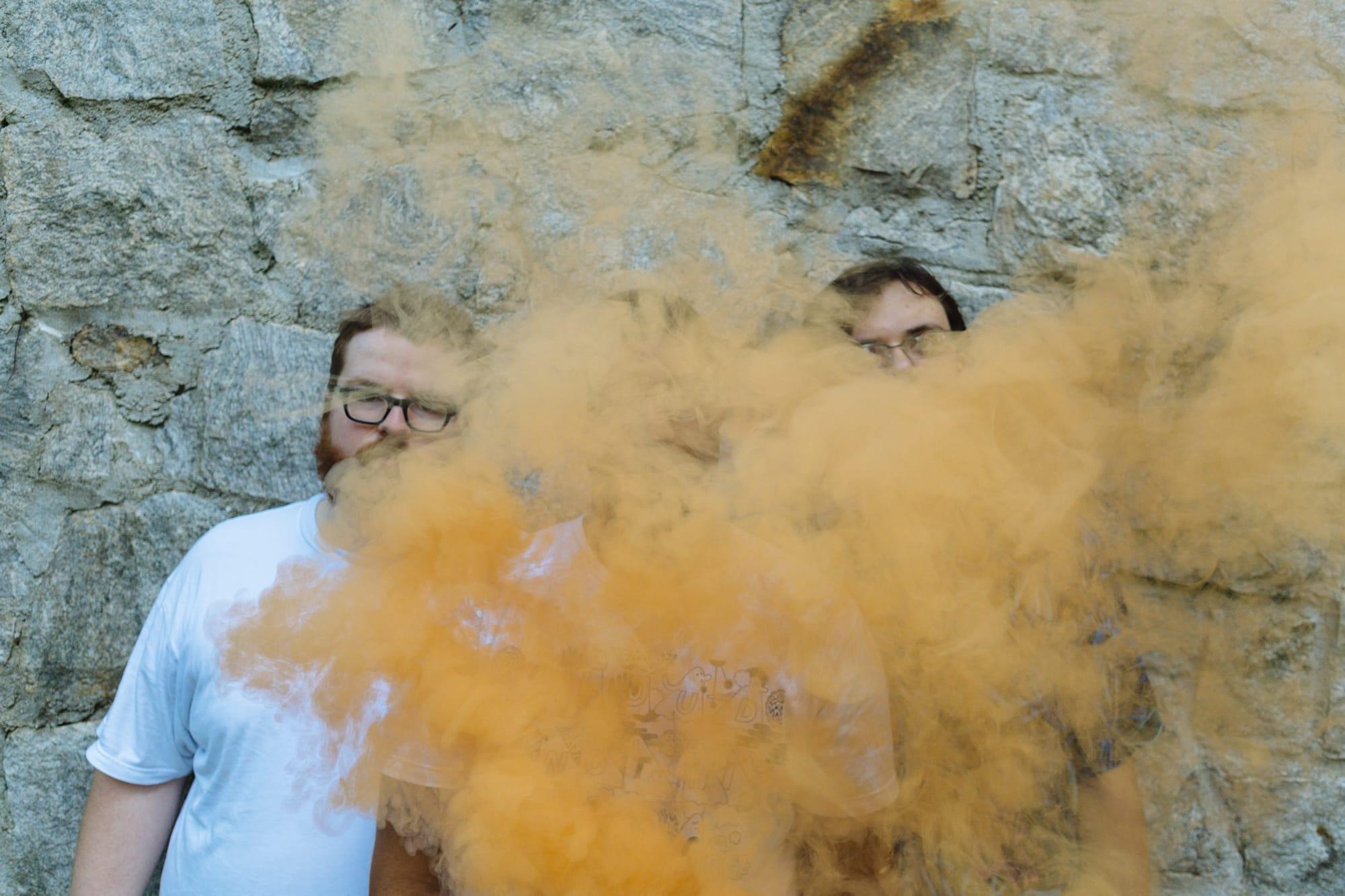 portrait of atlanta band Feverest with orange smoke