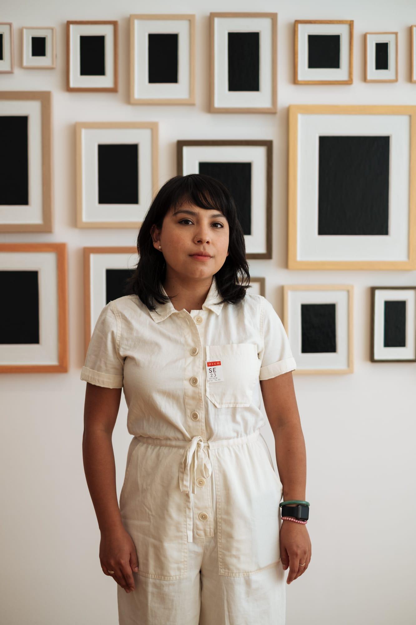 portrait of woman in front of an art exhibit