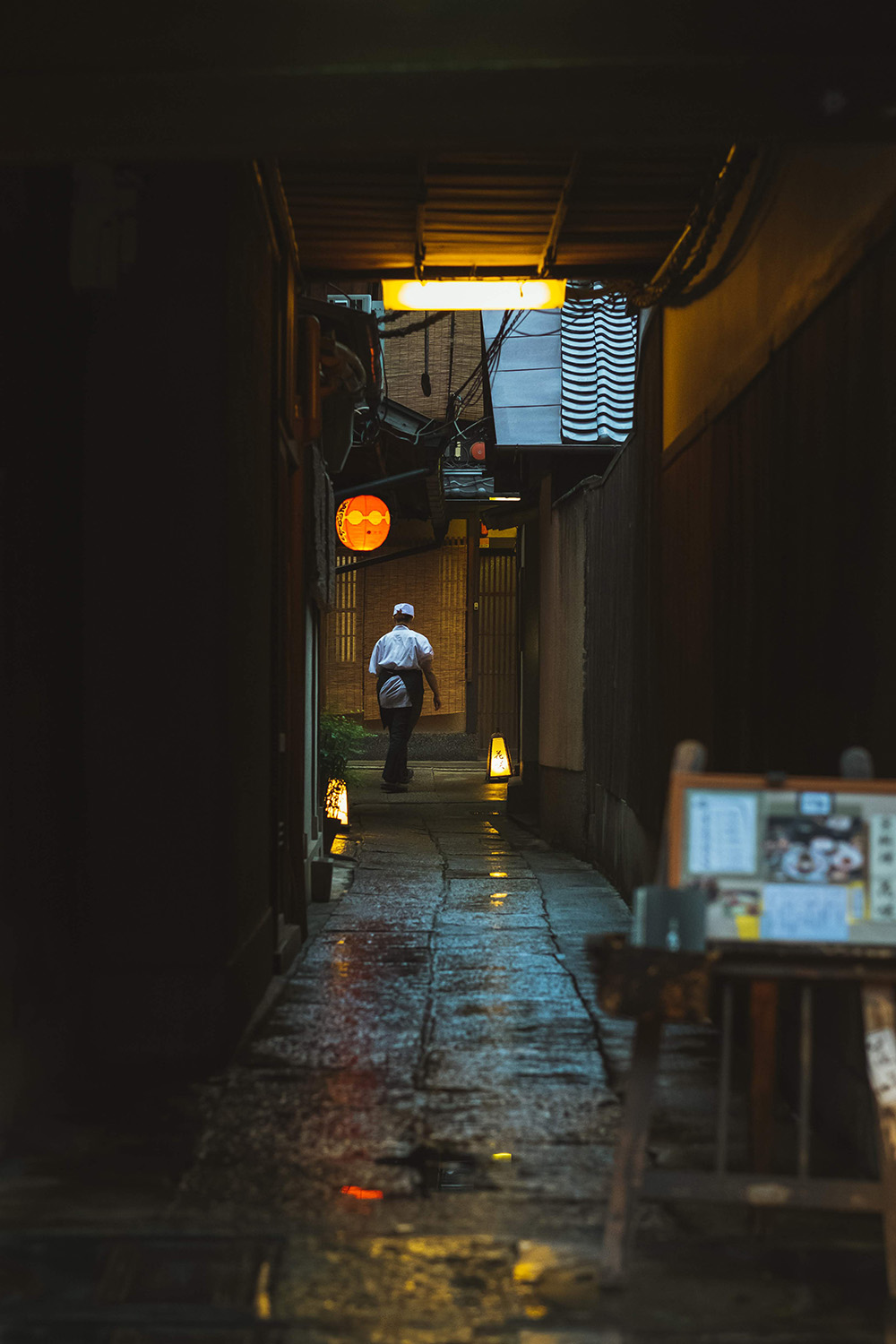 chef walking through alley