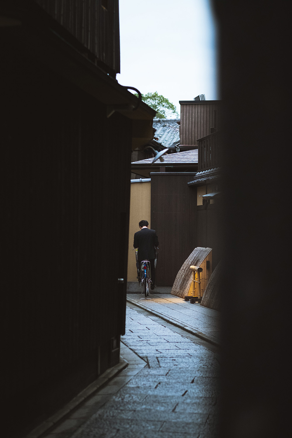 man waiting in alley