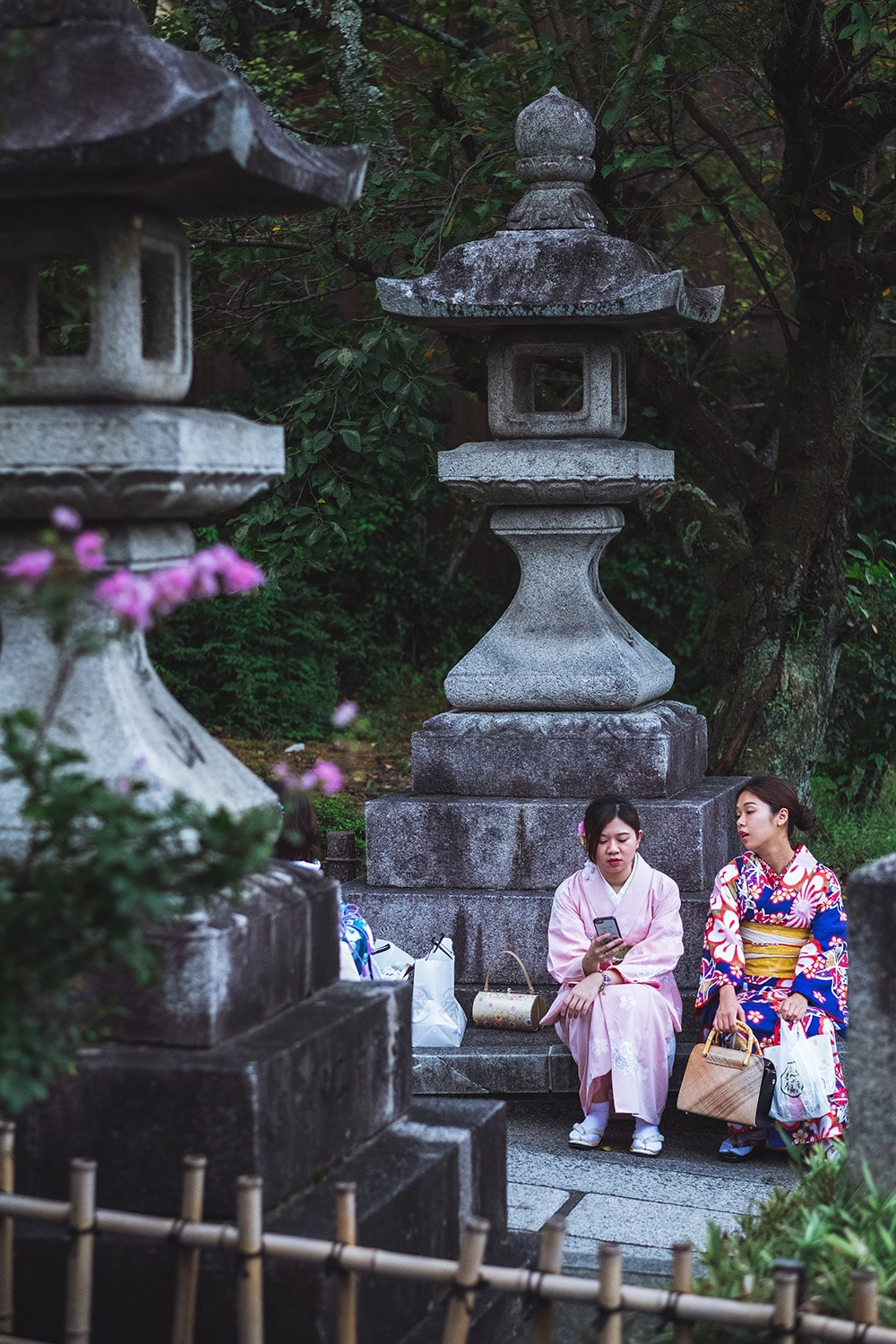 women wearing kimonos sitting