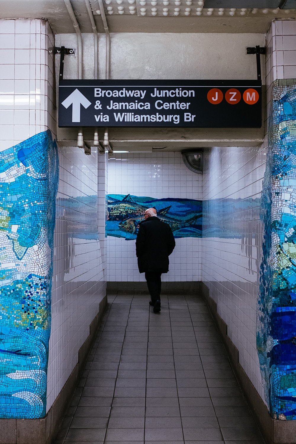 man walking in a subway station