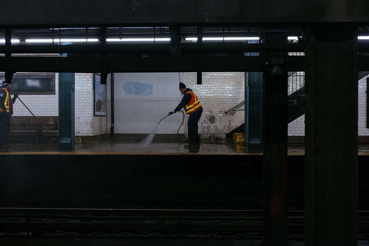 man cleaning a subway station