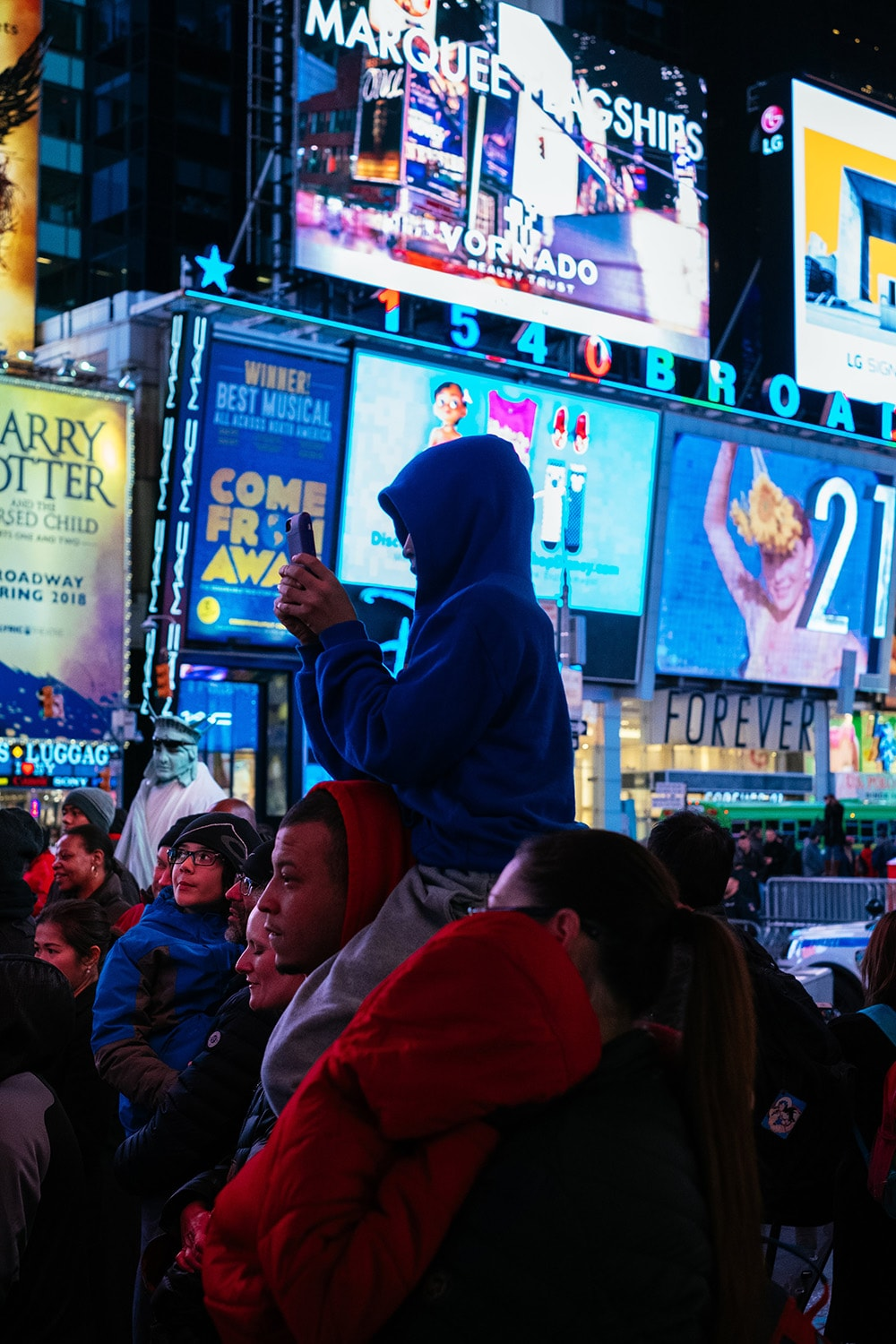 father and son in Times Square at night