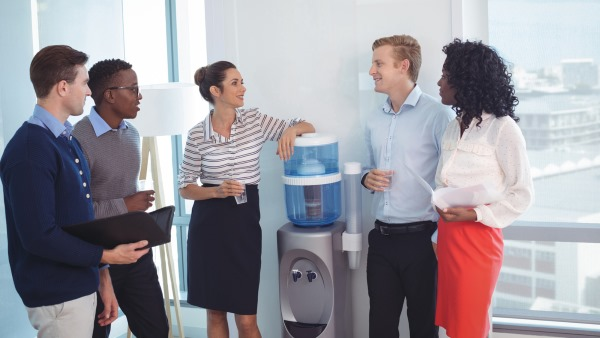 How a Strong Corporate Culture Defines your Brand colleagues standing around the water cooler
