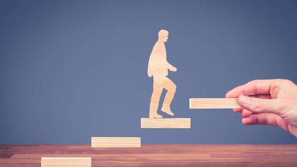 Climbing the Packaging Ladder: How to Make the Jump into Management man climbing to the next higher step