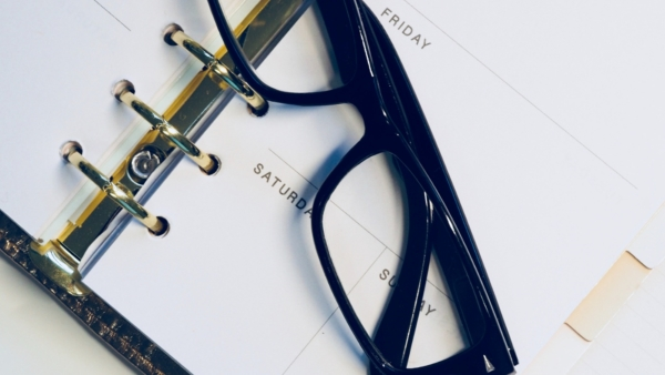 Career Planning Not Just for Students eyeglasses laying on a calendar