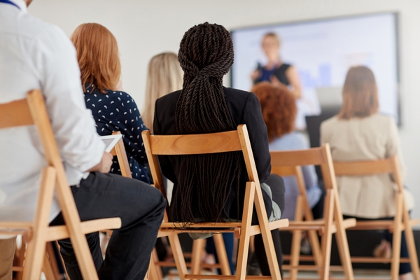How Brand Training Impacts Your Packaging Business Packaging Blog business professionals sitting on chairs attending a training