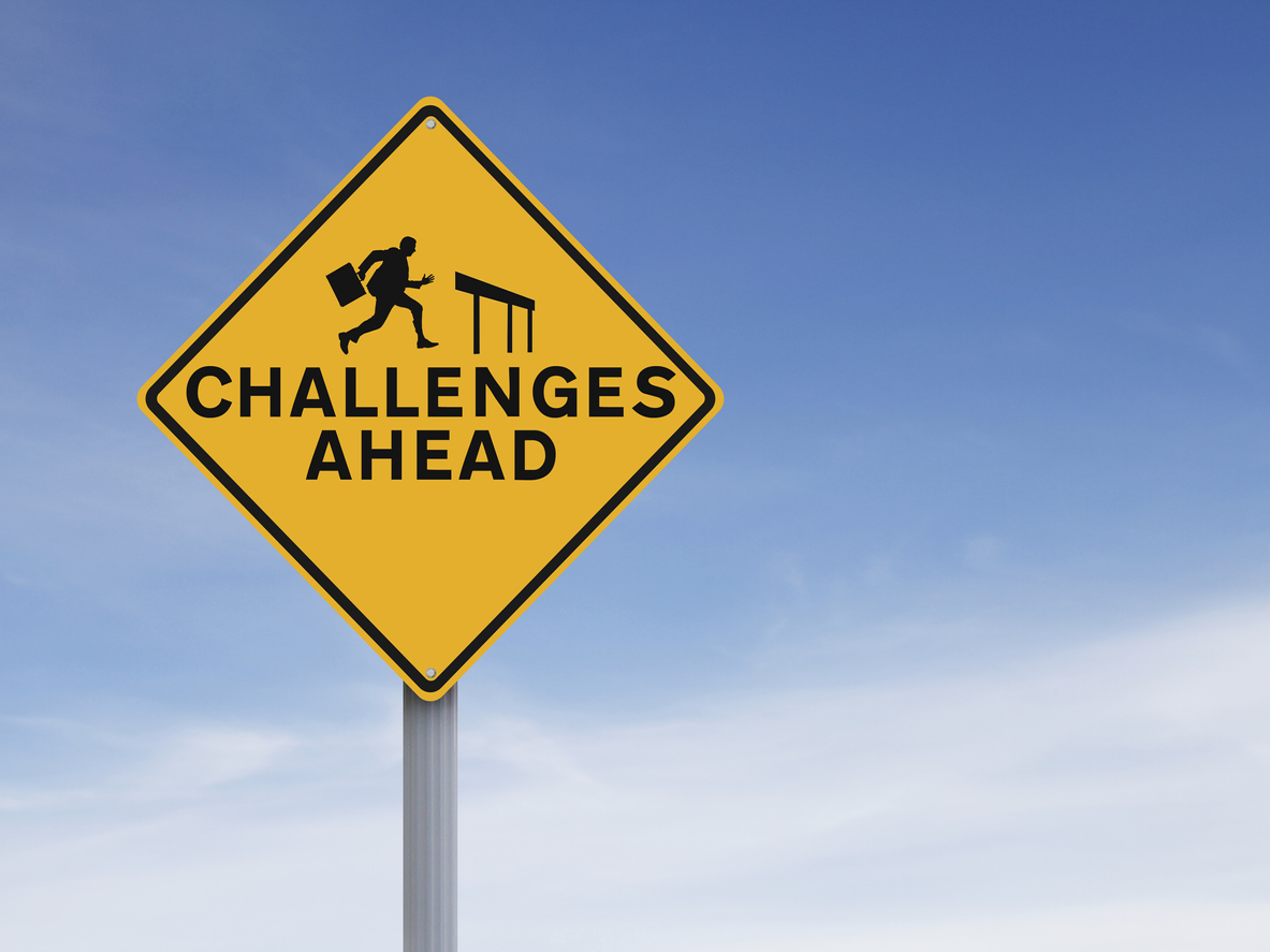 Talent Acquisition Challenges in the Packaging Industry | Road warning sign with business man on it
