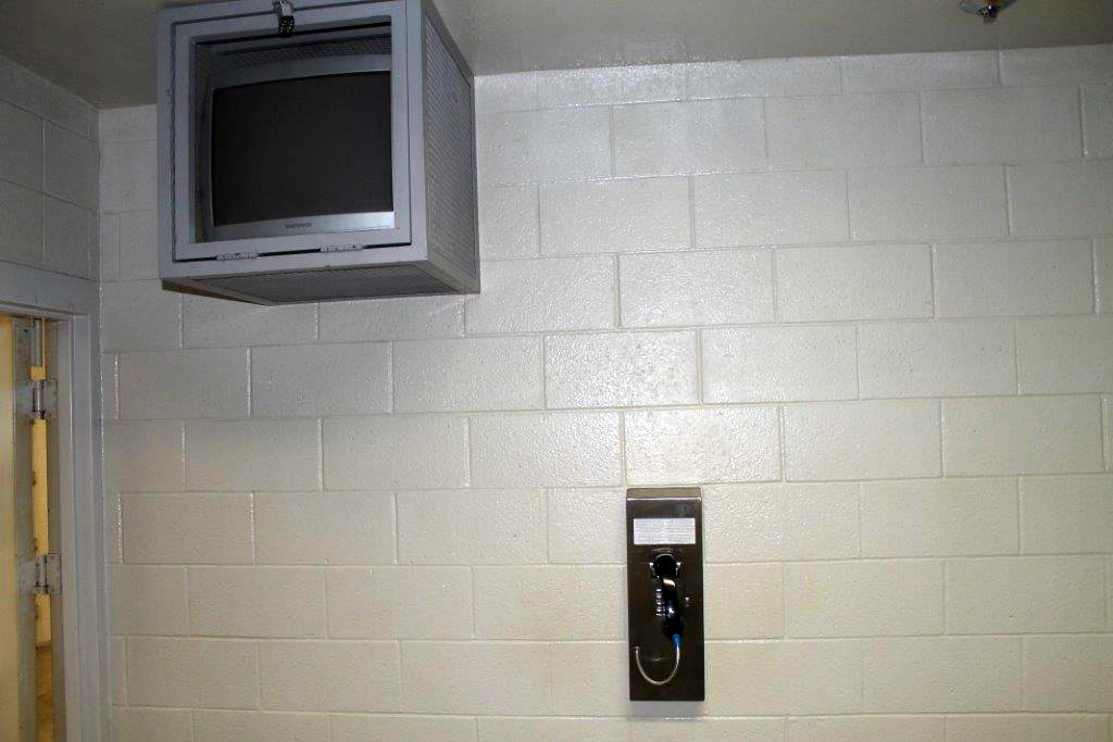 Photo of TV and Phone in Jail Cell